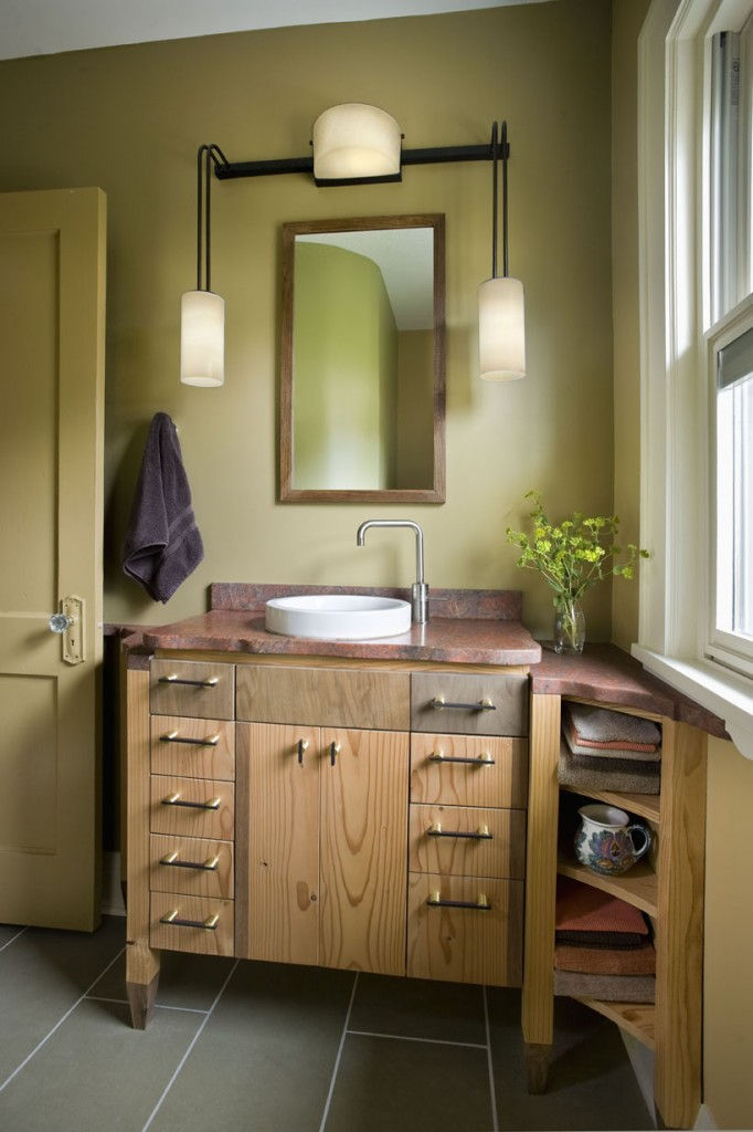 Bathroom showing custom vanity and window