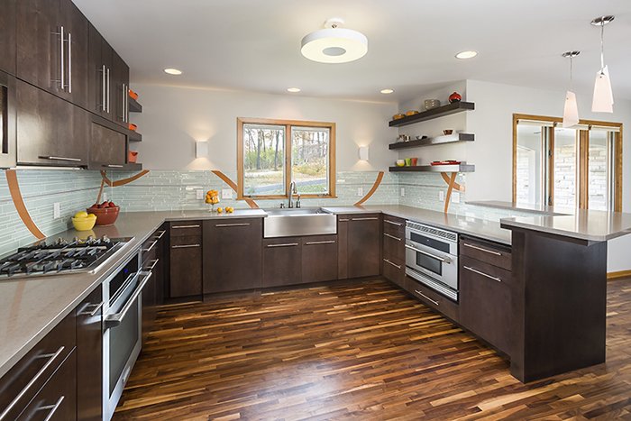 Modern kitchen with dark stained birch cabinets and colorful backsplash tile