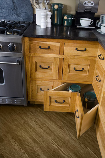 Corner of kitchen cabinets showing L-shaped corner drawers