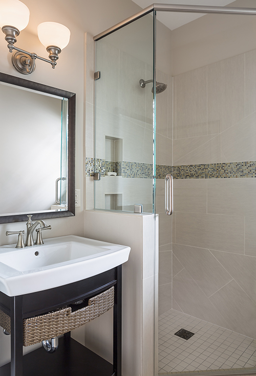 Small bathroom with small sink and walk-in shower