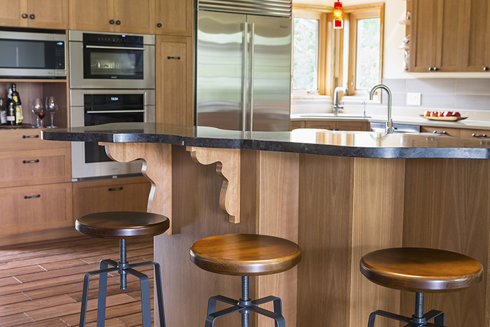 Close up of kitchen counter and supports with barstools