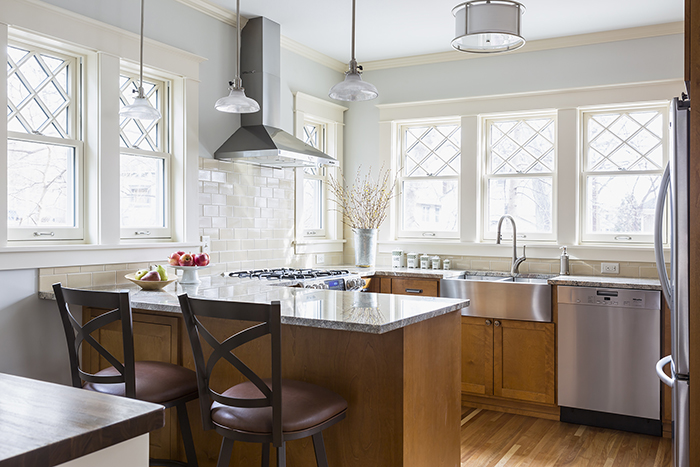 Light filled remodeled kitchen in older home with lots of windows