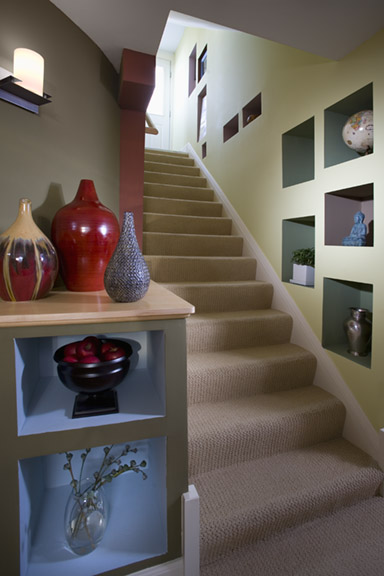 Stairway from basement with colorful walls and cubby holes